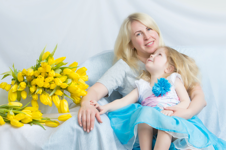 Happy mother and daughter about yellow tulips for sure