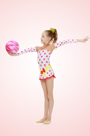 Gymnast does exercises with a ball
