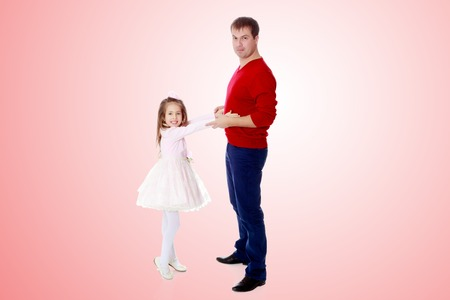 Little girl pulls her hands to his daddy. Stock Photo