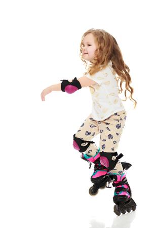 rollerskates: Little girl roller-skates.
