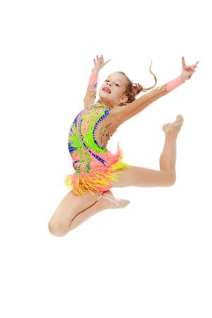 Girl gymnast performs a jump.