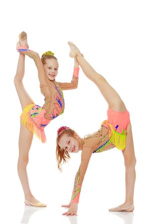 Two girls gymnast sitting on splits. Archivio Fotografico