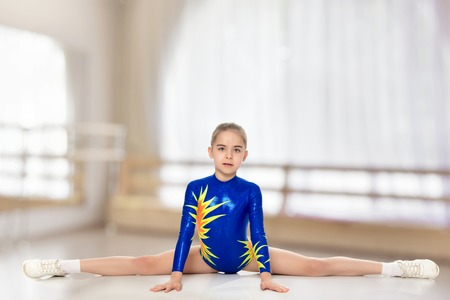 Girl gymnast doing the twine.