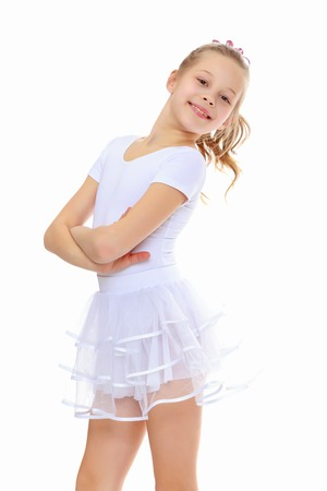 Girl gymnast in a white tracksuit.