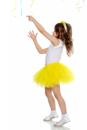 Little girl in a yellow skirt and white t-shirt.