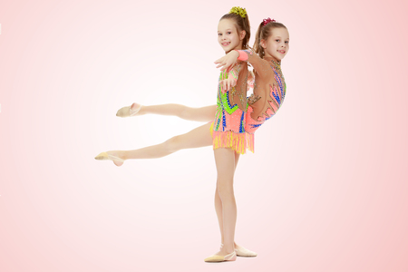 Two girls gymnast sitting on splits. Stock Photo