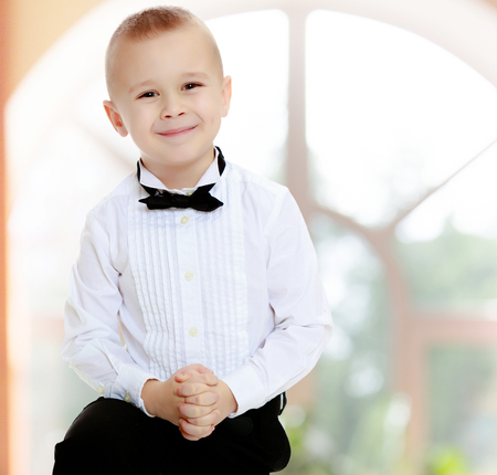 little boy in a white shirt and tie.