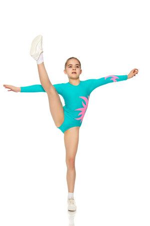Young girl acrobat perform exercises. Stock Photo