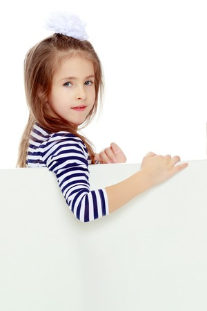 sign: Little girl in a striped dress. Stock Photo