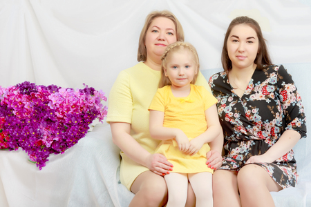 eldest: The mother with two daughters is the eldest and the youngest. Stock Photo