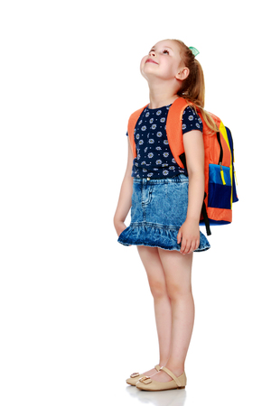 Little girl schoolgirl with flowers Banque d'images