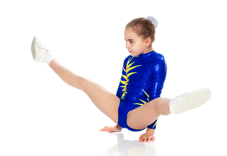 A girl gymnast performs exercises on the floor. Stockfoto