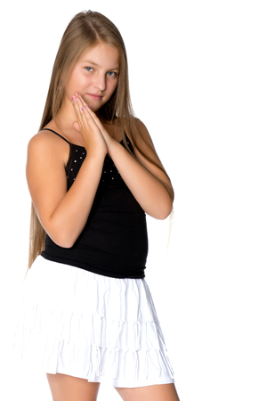 A teenage girl in a short white skirt and a black T-shirt.