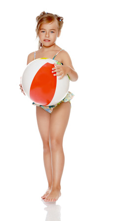 Little girl in a swimsuit with a ball Stock Photo
