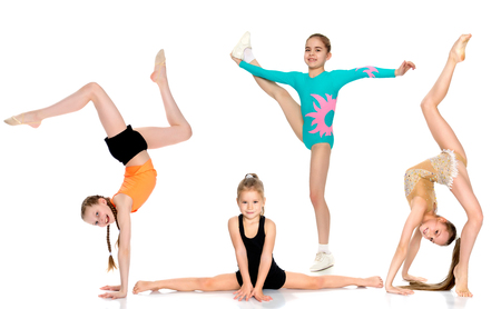 A group of girls gymnasts perform exercises. Archivio Fotografico
