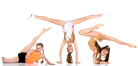A group of girls gymnasts perform exercises. Stok Fotoğraf
