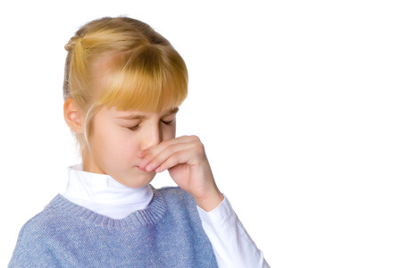 The little girl wipes her nose. Stock Photo