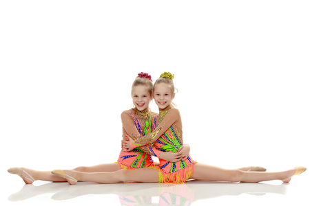 Two girls gymnast sitting on splits. Stockfoto