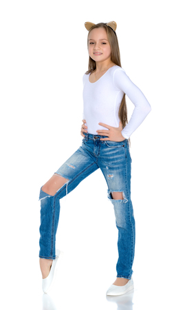 Beautiful teen girl in jeans with holes. Stock Photo