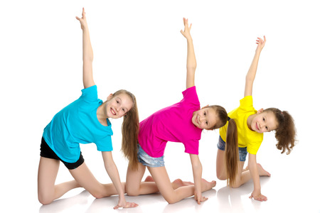 A group of girls gymnasts perform exercises. Stockfoto