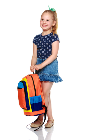 Little girl schoolgirl with flowers 스톡 콘텐츠