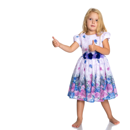 Little girl points with a finger Stock Photo