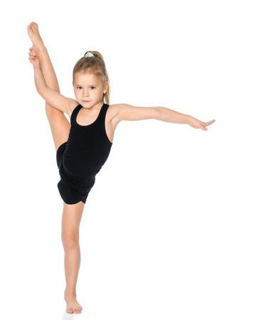 The gymnast balances on one leg.