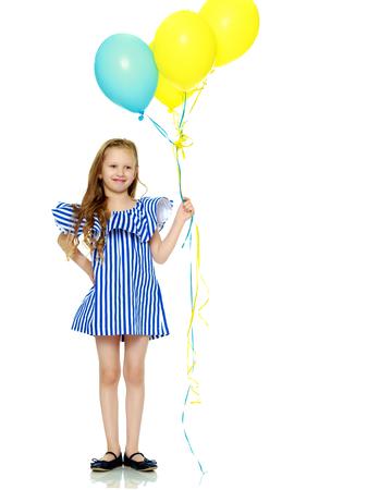Adorable little blond girl in very short summer striped dress.