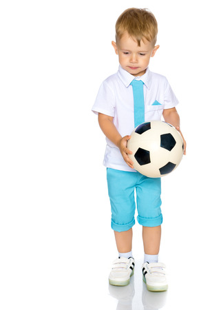 A little boy is playing with a ball. Stock Photo