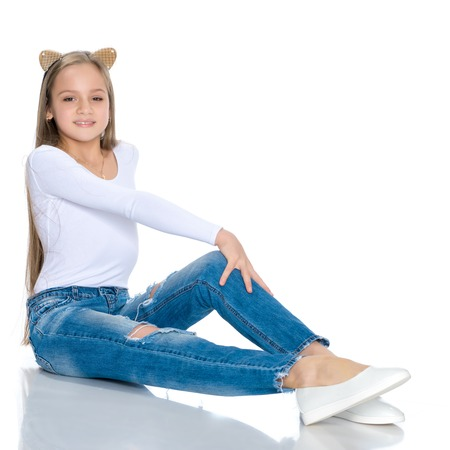 Beautiful teen girl in jeans with holes. Archivio Fotografico