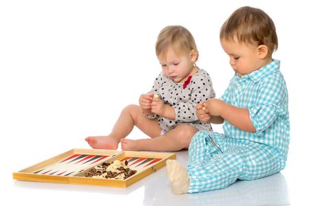Children play chess and backgammon. Stock Photo - 96774082