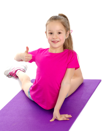 Little girl holding her thumb up