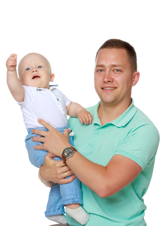 Dad is holding a baby Stock Photo