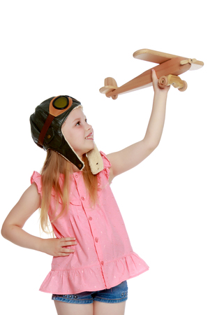 Little girl with a plane in her hand.