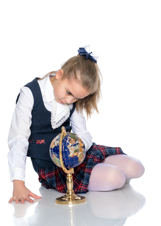 A little girl is studying the globe. Stock Photo