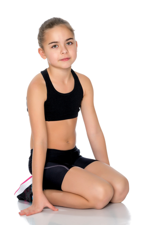 The gymnast prepares to perform the exercise. Stock Photo