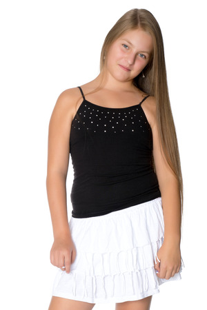 A teenage girl in a short dress. Stock Photo