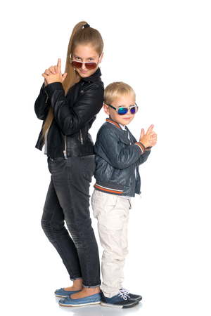 A teenage girl with her younger brother Stock Photo