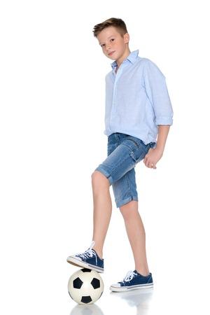 Boy teenager with a soccer ball. Standard-Bild