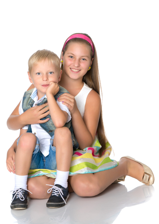 A teenage girl with her younger brother Stockfoto