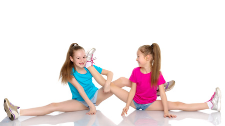 Girls gymnasts perform exercises on twine.