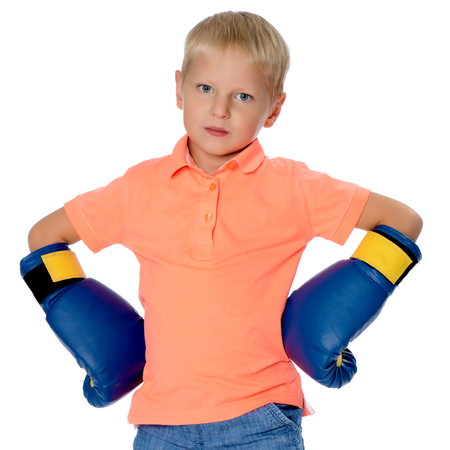 little boy in Boxing gloves.