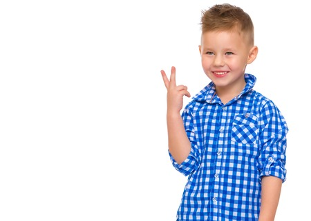 Little boy gestures with his hands.