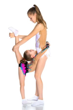 Girls gymnasts warm up. 스톡 콘텐츠