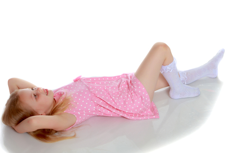Little girl lies on the floor