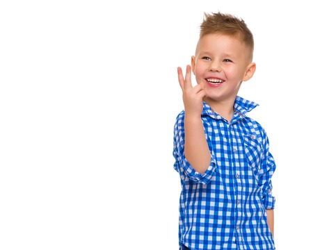 Little boy gestures with his hands.
