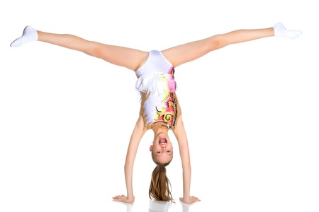 The gymnast performs a handstand with bent legs.