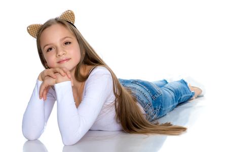 A teenage girl lies on the floor