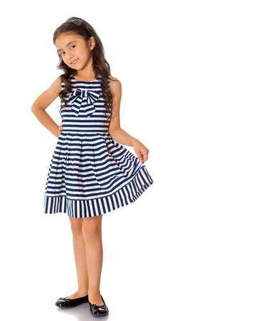 Trendy Asian little girl in full growth.
