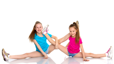Girls gymnasts perform exercises on twine. Archivio Fotografico